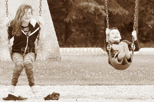 Kids on Swings – Sepia
