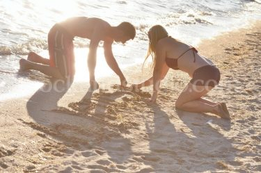 Writing in Sand Together